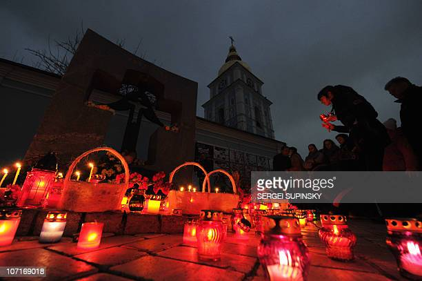 People set candles to commemorate the victims of the Holodomor or Hunger plague during memorial ceremony at Holodomor monument in Kiev on November 27...