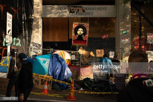 People set up a tent outside of the Seattle Police Departments East Precinct in the police-free zone known as the Capitol Hill Organized Protest on...
