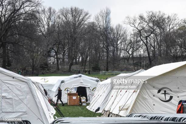 People set up an emergency field hospital to aid in the COVID19 pandemic in Central Park on March 30 2020 in New York City The field hospital is the...