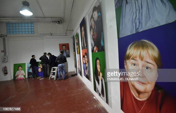 People set up an exhibition at LaVallee a 6000 squaremetre coworking space at the heart of the Brussels district of Molenbeek on November 14 2018 The...