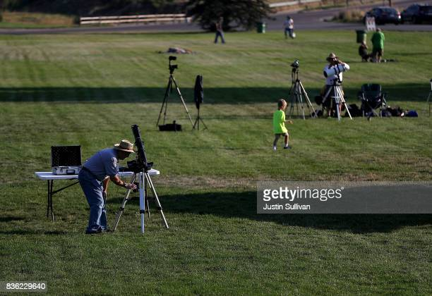 People set up cameras and telescopes as they prepare to watch the total eclipse at South Mike Sedar Park on August 21 2017 in Casper Wyoming Millions...