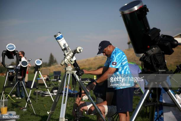 People set up cameras and telescopes to watch the solar eclipse at South Mike Sedar Park on August 21 2017 in Casper Wyoming Millions of people have...