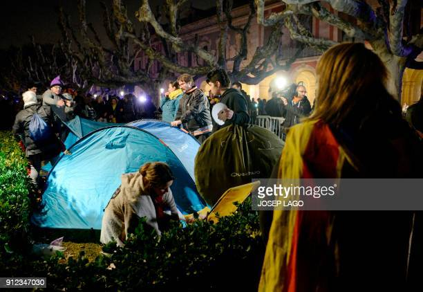 People set up tents to spend the night outside the Catalan parliament at the Ciutadella park on January 30 2018 in Barcelona The speaker of...