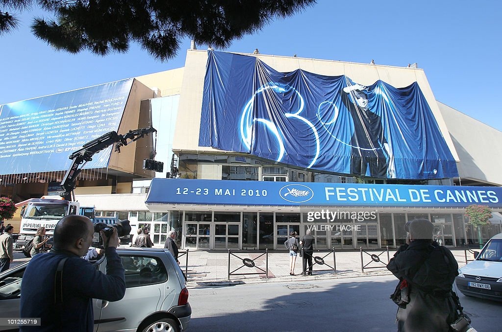 People set up the official poster of the Cannes' film festival 63rd edition on the Festivals' palace facade on May 10, 2010 in Cannes, southeastern France. US film-maker Tim Burton will head the jury at the Cannes film festival from May 12 to 23.
