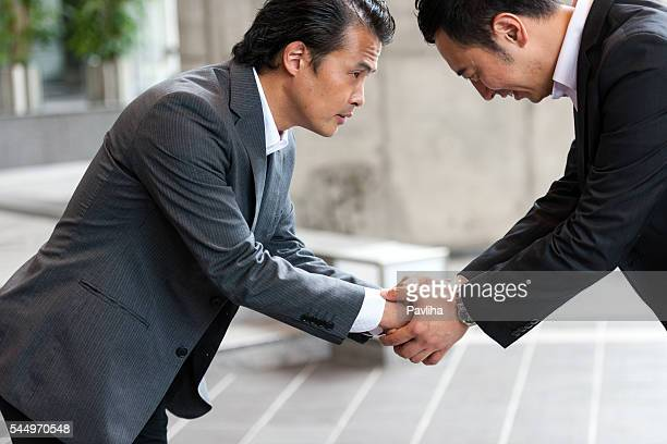 people shaking hands,business people,kyoto,japan - pavliha stock photos and pictures