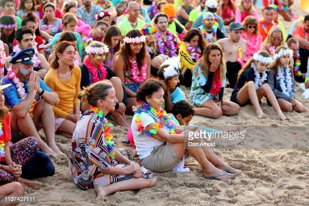 People share a moment of quiet reflection at Bondi Beach on March 22 2019 in Sydney Australia Surfers gather to celebrate five years of OneWave a not...