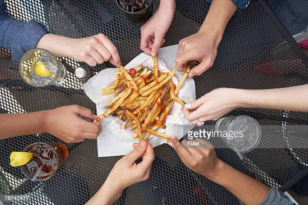 People Sharing French Fries
