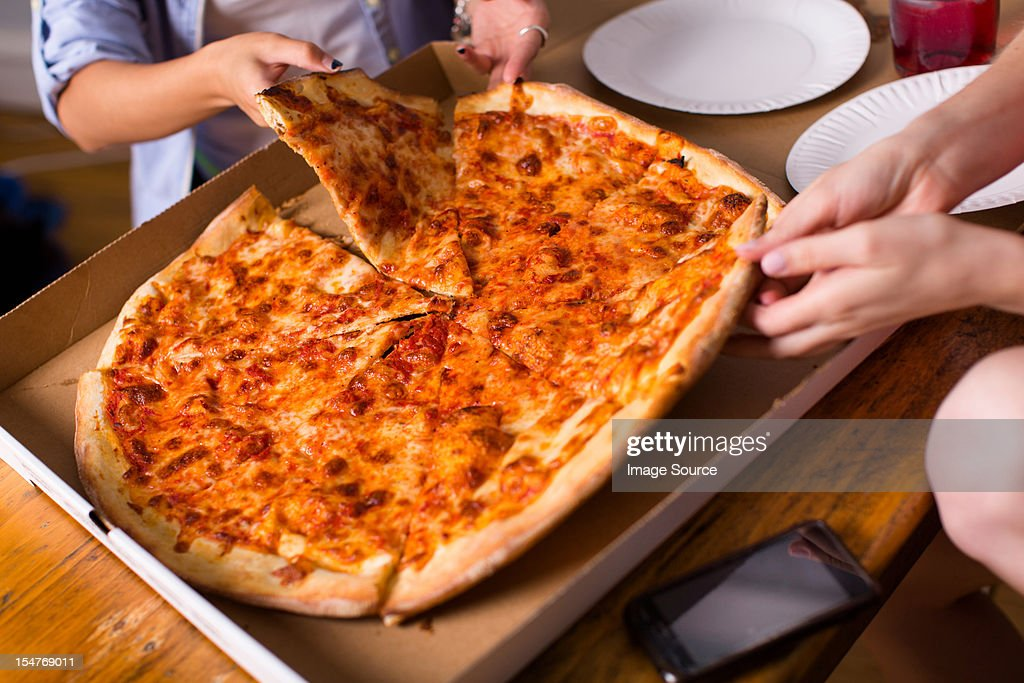 People sharing takeaway pizza : Stock Photo