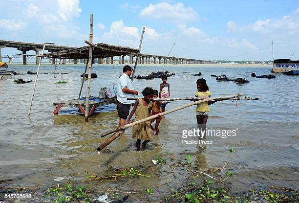 People shift to a safe place after most of the Sangam area was submerged with flood water of River Ganga and Yamuna in Allahabad