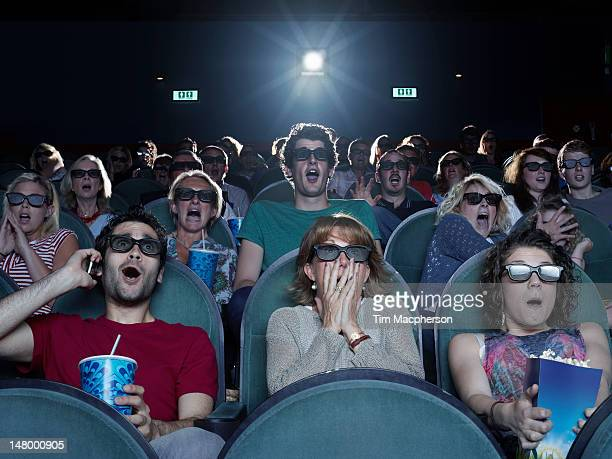 people shocked while watching a movie - audience stock pictures, royalty-free photos & images
