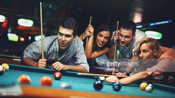People shooting pool.