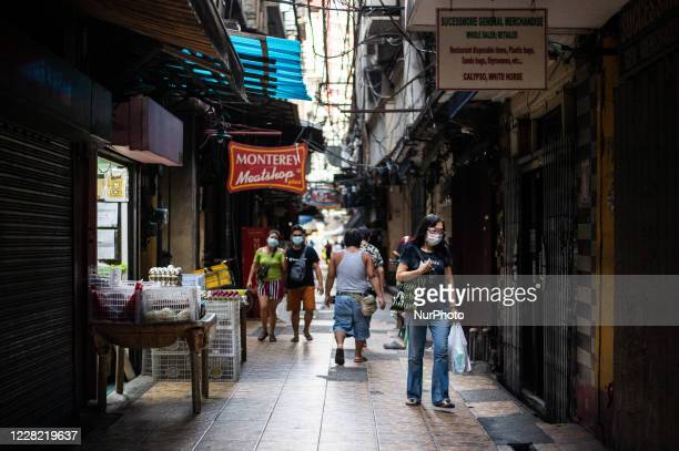 People shop and walk in Chinatown in Manila, Philippines on August 26, 2020. The Philippines economy shrank by 16.5% in the second quarter amid the...