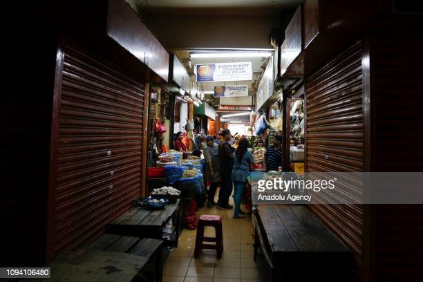 People shop as some shops are seen closed during Chinese New Year celebration in Kuala Lumpur Malaysia on February 5 2019 Malaysian government set...