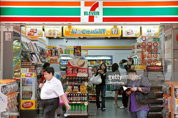 People shop at a 7Eleven store in Hong Kong China on Wednesday March 2 2011 Dairy Farm International Holdings Ltd and its subsidiaries operate retail...