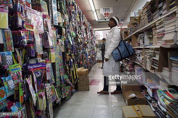 People shop at a 99 cent store October 23 2008 in Brooklyn New York A new government report by the Labor Department showed that the number of US...