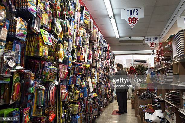 People shop at a 99 cent store October 23 2008 in Brooklyn New York new government report by the Labor Department showed that the number of US...