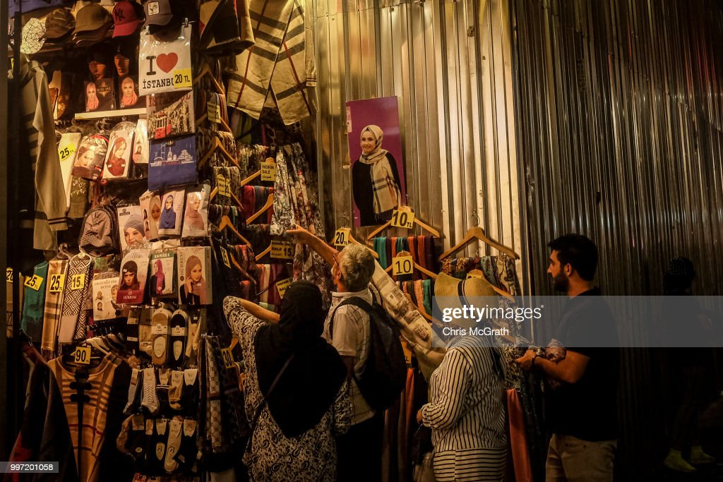 People shop at a clothing store on July 12, 2018 in Istanbul Turkey. Following Turkey's President Recep Tayyip Erdogan's re-election victory and the appointment of his son-in-law Berat Albayrak to lead the Treasury and Finance Ministry fears are growing that Turkey's economy is heading into crisis . The Turkish Lira, has plunged by approximately one-fifth this year raising prices for businesses and households.