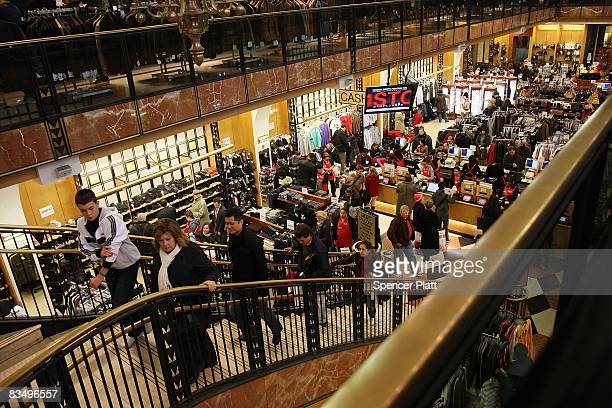 People shop at a department store October 30 2008 in New York City According to reports the American economy shrank 03 percent during the third...