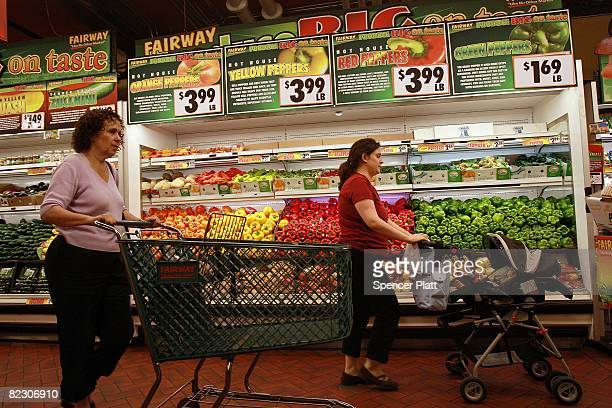 People shop at a Fairway grocery store August 14 2008 in the Brooklyn borough of New York City A new government report has shown that US inflation...