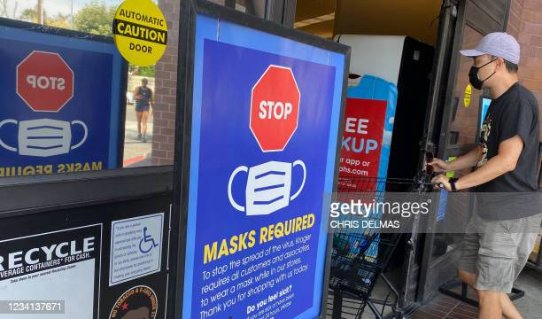 People shop at a grocery store enforcing the wearing of masks in Los Angeles on July 23, 2021. - With the Delta variant pushing US Covid cases back...
