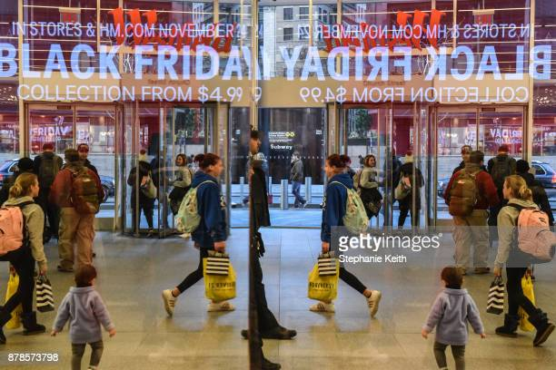 People shop at a HM store on Black Friday on November 24 2017 in New York City