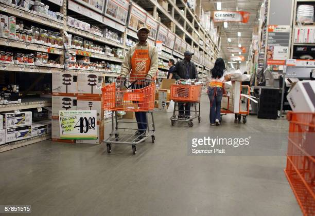 People shop at a Home Depot store May 19 2009 in Brooklyn borough of New York City Home Depot the country�s largest home improvement retailer...