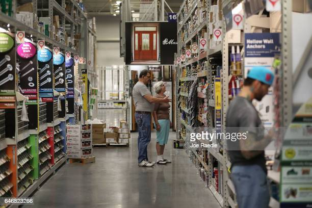 People shop at a Lowe's store on the day the company reported a rise in earnings on March 1 2017 in Hialeah Florida Lowe's reported fourthquarter...