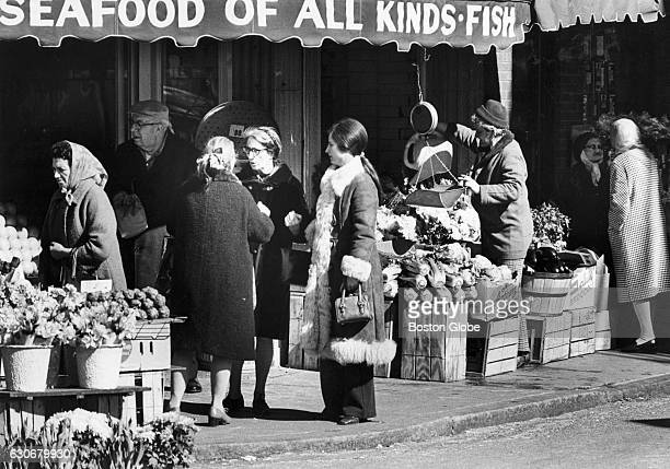 People shop at a market at the corner of Cross Street and Salem Street in Boston's North End on March 26 1973