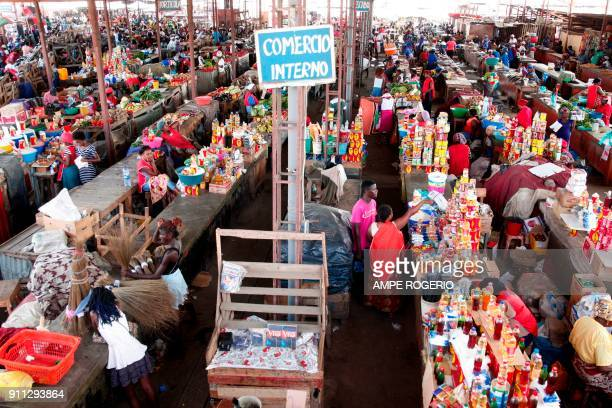 People shop at a market in Luanda Angola on January 19 2018 Angolan President Joao Lourenco was elected five months ago promising an economic miracle...