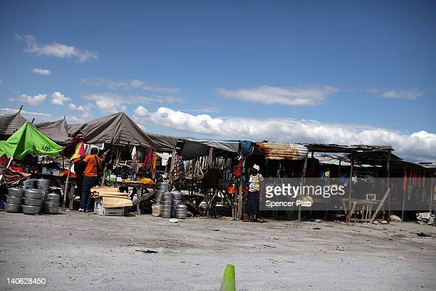 People shop at a market on March 3 2012 in the border town of Tierra Nueva Dominican Republic The Dominican border is a poor and neglected part of...