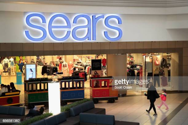 People shop at a Sears store on March 22 2017 in Schaumburg Illinois Sears Holdings the parent of Kmart and Sears Roebuck Co said there is...
