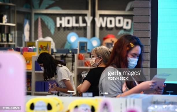 People shop at a store in Hollywood, California, on July 19 the second day of the return of the indoor mask mandate in Los Angeles County due to a...