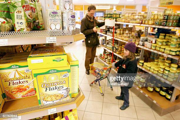 People shop at a store of German organic supermarket chain EO Komma on March 2 2005 in Berlin Germany According to the Londonbased organization...