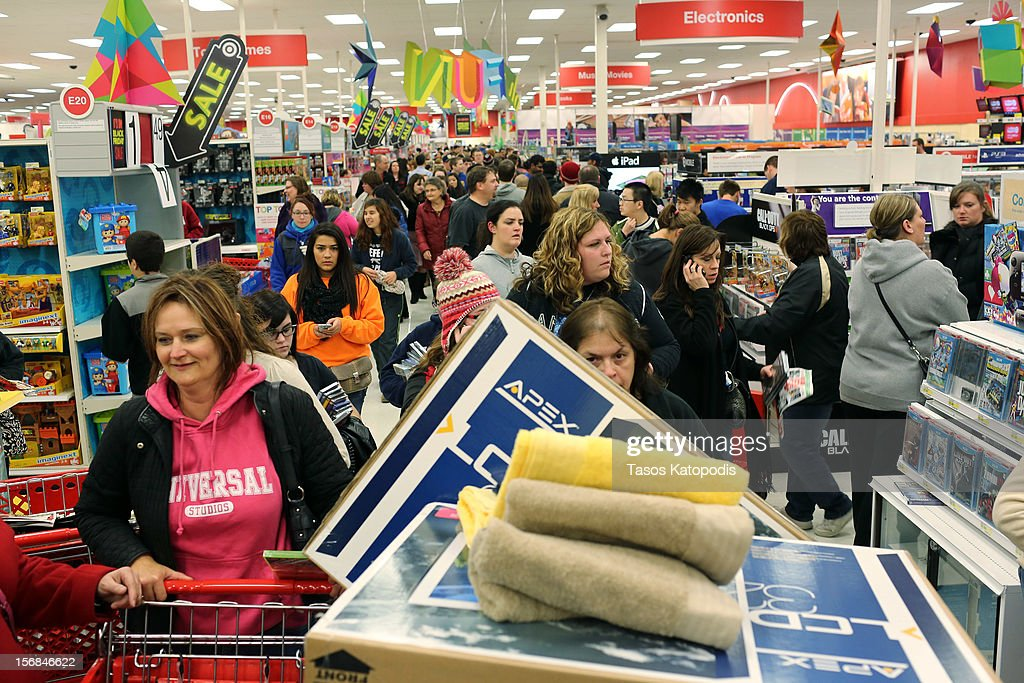 People shop at a Target on Thanksgiving night November 22, 2012 in Highland, Indiana. Many stores got a head start on the traditional Black Friday sales by opening on Thanksgiving.