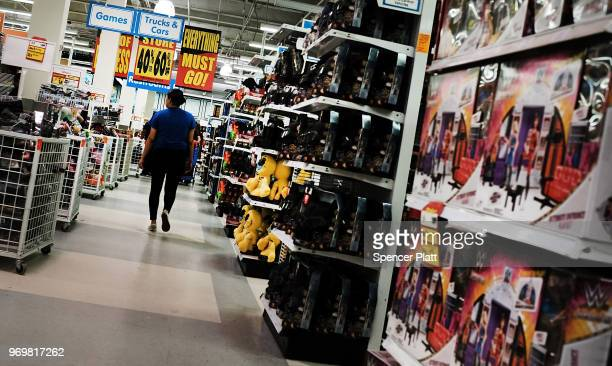 People shop at a Toys R Us store in Brooklyn on June 8, 2018 in New York City. All 735 Toys R Us stores in America are set to close by the end of...