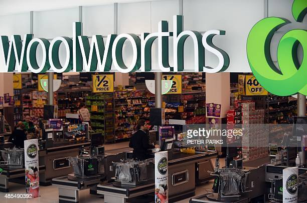People shop at a Woolworths store in Sydney on August 28 2015 Australian supermarket giant Woolworths on August 28 posted a 125 percent slide in...
