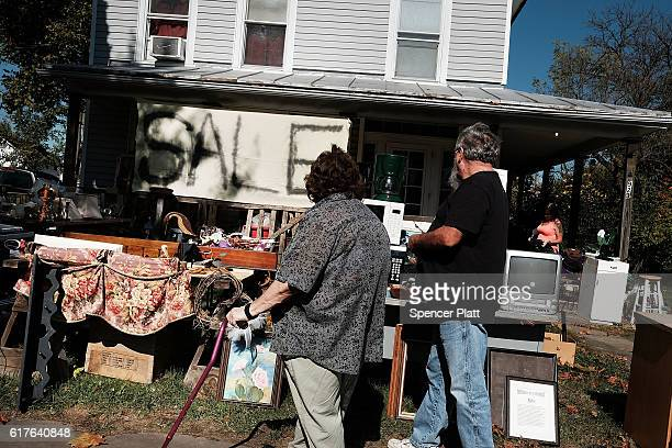 People shop at a yard sale outside of Coshocton on October 23 2016 in Coshocton Ohio Ohio has become one of the key battleground states in the 2016...