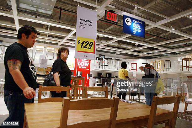 People shop at an Ikea home furnishing store August 14 2008 in the Brooklyn borough of New York City A new government report has shown that US...