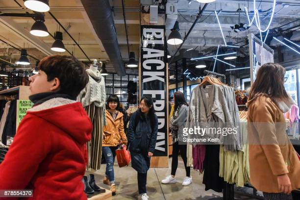 People shop at an Urban Outfitters store on 'Black Friday' on November 24 2017 in New York City