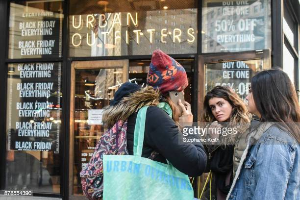People shop at an Urban Outfitters store on Black Friday on November 24 2017 in New York City