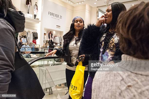 People shop at Forever 21 on December 24, 2016 in New York City. Last-minute shoppers hit the stores the day before Christmas.