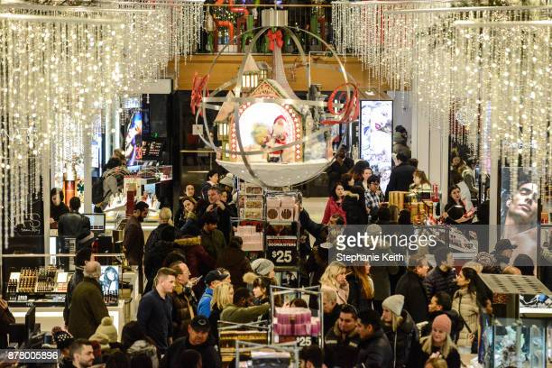 People shop at Macy's department store on Black Friday on November 23 2017 in New York City Black Friday starts earlier in the season on Thanksgiving...