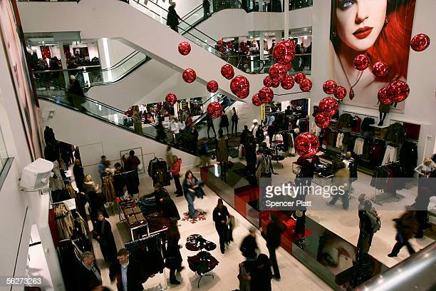 People shop at merchandise in an H M clothing store on 'Black Friday' November 25 2005 in New York City With many retailers using giveaways and price...