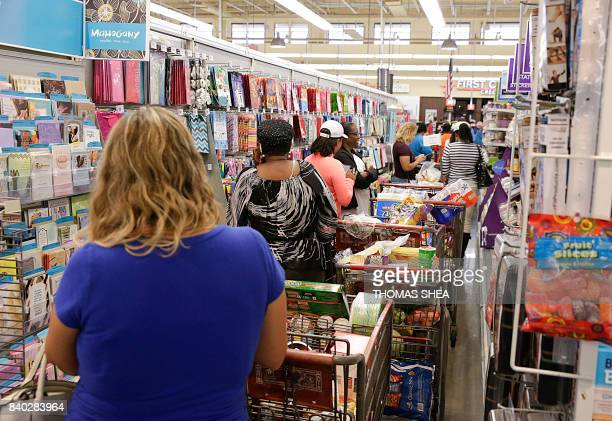 People shop at Sienna Market as a mandatory evacuation was issued for Sienna Plantation residents in Missouri City Texas on August 28 2017 Rescue...