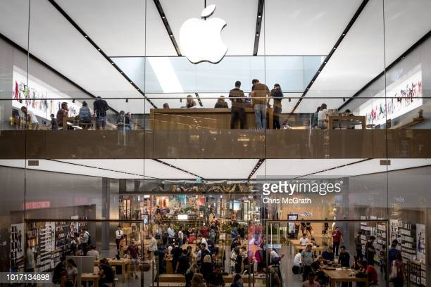 People shop at the Apple Store in the Zorlu luxury shopping mall on August 15 2018 in Istanbul Turkey The Turkish Lira recovered to trade at 61 USD...