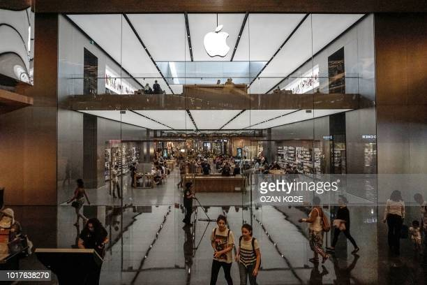 People shop at the Apple store on August 16 at Zorlu shopping center at Zincirlikuyu district in Istanbul Turkey hiked on August 16 2018 tariffs on...