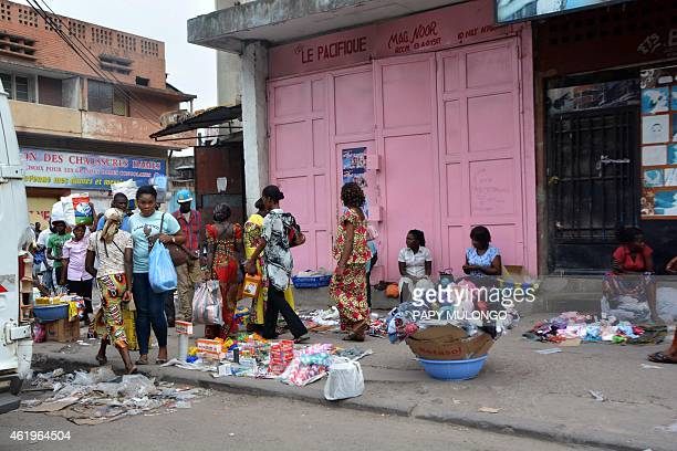 People shop at the few stores open at the Zando market in Kinshasa on January 22, 2015 on the fourth day of violent protests against President Joseph...