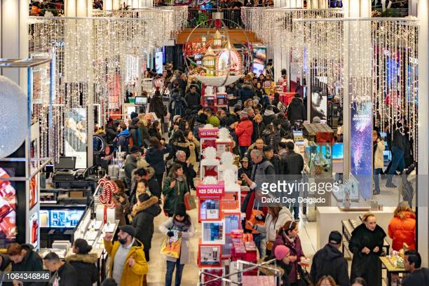 People shop at the Herald Square Macy's Flag ship store for the early Black Friday sales on November 22 2018 in New York City Known as 'Black Friday'...