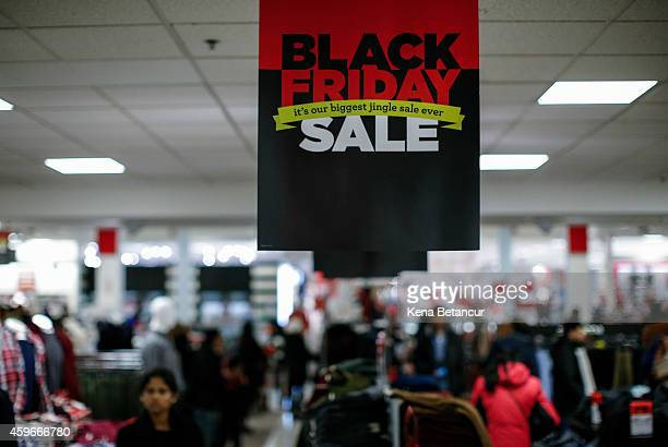 People shop at the JCPenney store at the Newport Mall on November 27 2014 in Jersey City New Jersey Black Friday sales which now begin on the...