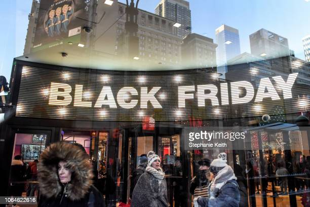 People shop at the Macy's flagship store on 34th St on Black Friday on November 23 2018 in New York City The day after Thanksgiving Black Friday is...